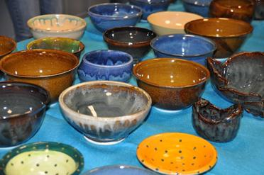 A row of beautiful hand crafted bowls you get to choose from.